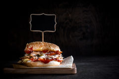 Chicken burger with sliced meat and chalkboard Royalty Free Stock Photography