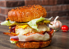 Chicken burger with tomato onion cheese lettuce Royalty Free Stock Image