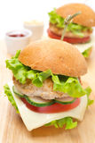 Chicken burger with vegetables, cheese, ketchup and mustard Royalty Free Stock Photos