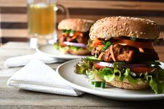 Chicken burger on the wood table. We love burger party and beer very fun and enjoy Royalty Free Stock Photography