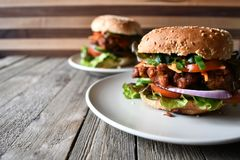 Chicken burger on the wood table. We love burger party and beer very fun and enjoy Stock Photography