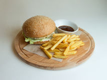 Chicken Burger on a wooden Board stock photography