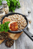 Chicken burgers and buckwheat Royalty Free Stock Photography