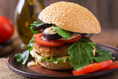 Chicken burgers with tomato and eggplant - sandwich. Royalty Free Stock Photography