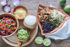 Chicken burrito bowl with the ingredients Stock Photo