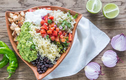 Chicken burrito bowl. On the wooden table Royalty Free Stock Image