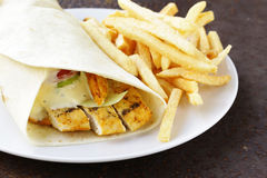 Chicken burrito and French fries Royalty Free Stock Photo