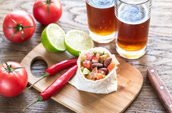 Chicken burrito with glasses of beer Royalty Free Stock Photos
