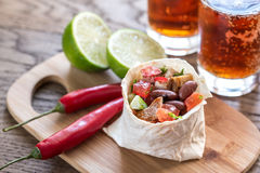 Chicken burrito with glasses of beer Royalty Free Stock Photo