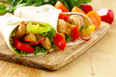 Chicken burrito with radishes, sweet peppers Royalty Free Stock Image