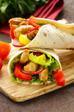 Chicken burrito with radishes, sweet peppers Royalty Free Stock Images