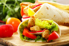 Chicken burrito with radishes, sweet peppers Stock Photo