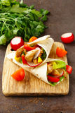 Chicken burrito with radishes, sweet peppers Royalty Free Stock Photos