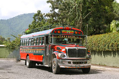 Chicken Bus Guatemala. Typical bus for cheap public transport in Guatemala emitting a dark cloud of diesel Stock Photos