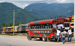 Chicken bus last minute, Antigua, Guatemala. Young men arriving at last minute for transportation Stock Photography