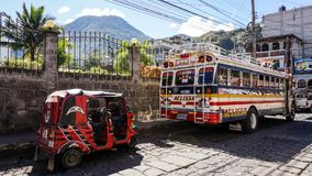 Chicken Bus with Tuktuk in Antigua, Guatemala. royalty free stock image
