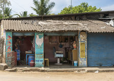 Chicken butcher and barber shop as neighbors. Royalty Free Stock Photos
