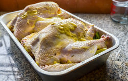 Chicken with butter in tray Stock Images