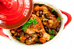 Chicken Cacciatore. In a red crock pot, ready to serve.  Overhead view, over white background Stock Photo
