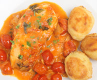 Chicken Cacciatore. Italian chicken cacciatore with cherry tomatoes, mascarpone and basil. Served with roasted potatoes Stock Photos