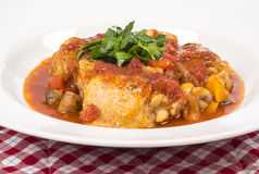 Chicken Cacciatore #2. Chicken cooked in tomato based sauce with red bell peppers and mushrooms, garnished with Italian flat leaf parsley #2 royalty free stock photo