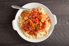 Chicken Cacciatore over pasta above shot Stock Photos