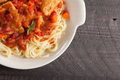 Chicken Cacciatore over pasta top view Stock Images