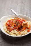 Chicken Cacciatore over pasta vertical shot Stock Photo