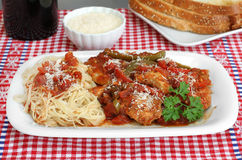 Chicken Cacciatore with pasta and a side of bread. Royalty Free Stock Photo