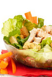 Chicken Caesar Salad. A bowl of chicken Caesar salad isolated on white Royalty Free Stock Image