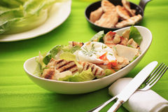 Chicken Caesar Salad. With poached egg, grilled chicken, lettuce, croutons caesar dressing Stock Image