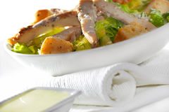 Chicken Caesar salad. Fresh Chicken Caesar salad and dip stock photography