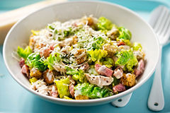 Chicken caesar salad with bacon, parmesan and herb croutons Stock Images
