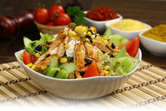 Chicken Caesar Salad. On the black bowl Stock Image