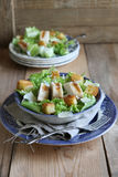 Chicken Caesar salad with cheese and croutons. Chicken Caesar salad with cheese and lettuce Royalty Free Stock Photo