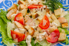 Chicken Caesar salad. Classic Chicken Caesar Salad with parmesan and tomato Royalty Free Stock Photo