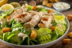 Chicken Caesar Salad. A delicious chicken caesar salad with parmesan cheese, dressing and croutons Stock Image