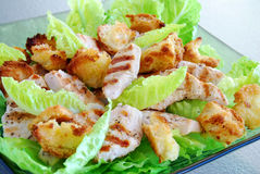 Chicken caesar salad. On glass plate Royalty Free Stock Image
