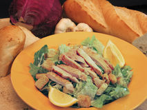 Chicken Caesar Salad. With Parmesan Cheese on Staged Background Royalty Free Stock Photography