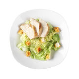 Chicken Caesar salad on the white background. Chicken Caesar salad on a plate on white background Stock Photo