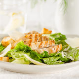 Chicken Caesar salad. On the white plate Royalty Free Stock Images