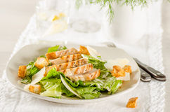 Chicken Caesar salad. On the white plate Stock Photos