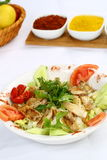 Chicken Caesar Salad. On the white plate Royalty Free Stock Photo