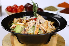 Chicken Caesar Salad. On the white plate Royalty Free Stock Image