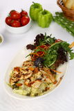 Chicken Caesar Salad. On the white plate Royalty Free Stock Photos