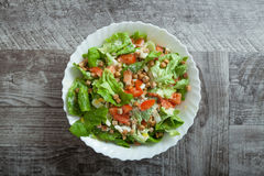 Chicken caesar salad. On wooden table Royalty Free Stock Photography
