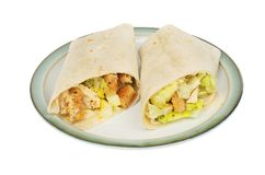 Chicken Caesar salad wraps. On a plate isolated against white royalty free stock photos