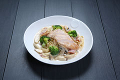 Chicken Carbonara with green broccoli and mushroom on white plat Royalty Free Stock Photos