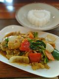 Chicken with cashew nut. Chicken meal with a heart shaped rice Royalty Free Stock Image