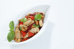Chicken cashew nuts. Chicken with cashew nuts, chili, capsicum and snow peas on a white background Royalty Free Stock Image